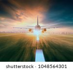 air plane flying over airport... | Shutterstock . vector #1048564301
