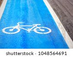 concrete road painted for... | Shutterstock . vector #1048564691