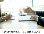 business man and lawyer looking ... | Shutterstock . vector #1048566641