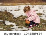 young smiling girl picking... | Shutterstock . vector #1048589699