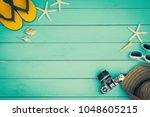 accessory summer on vintage... | Shutterstock . vector #1048605215