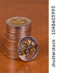 several aligned ripple coins on ... | Shutterstock . vector #1048605995