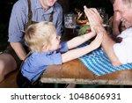portrait of young bavarian boy... | Shutterstock . vector #1048606931