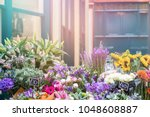 flower stall with a variety of... | Shutterstock . vector #1048608887