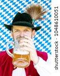 portrait of bavarian man... | Shutterstock . vector #1048610051