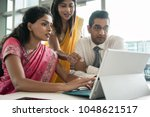 three creative indian employees ... | Shutterstock . vector #1048621517