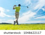 full length rear view of a man... | Shutterstock . vector #1048622117