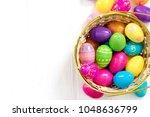easter eggs in basket on wooden ... | Shutterstock . vector #1048636799