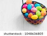 easter eggs in basket on wooden ... | Shutterstock . vector #1048636805
