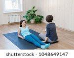 trainer having physical... | Shutterstock . vector #1048649147