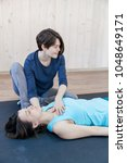 trainer doing special therapy... | Shutterstock . vector #1048649171