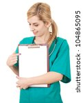 young woman doctor with stethoscope showing something on clipboard, white background - stock photo