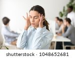 Small photo of Stressed frustrated young woman employee feeling pain unwell dizzy, tired of difficult office job, suffering from panic attack, hormone imbalance or having headache migraine massaging temples at work