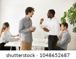 friendly multiracial young... | Shutterstock . vector #1048652687