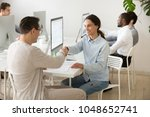 smiling colleagues partners... | Shutterstock . vector #1048652741