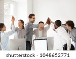 excited multiracial colleagues... | Shutterstock . vector #1048652771