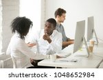 serious african colleagues... | Shutterstock . vector #1048652984