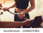 woman exercise barbell with... | Shutterstock . vector #1048655381