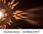 arabian lantern on wooden floor.... | Shutterstock . vector #1048661447