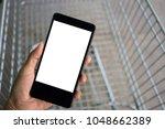 woman hand holding smartphone... | Shutterstock . vector #1048662389