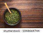 raw homemade argentinian green... | Shutterstock . vector #1048664744