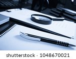 office desk table with supplies.... | Shutterstock . vector #1048670021