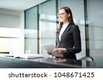 young businesswoman or delegate ... | Shutterstock . vector #1048671425