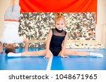 family in trampoline center | Shutterstock . vector #1048671965