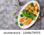 chicken fillet cooked on a... | Shutterstock . vector #1048678955