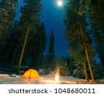 winter camping with fire at...   Shutterstock . vector #1048680011