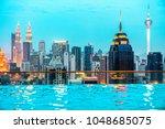 kuala lumpur  malaysia. sunset... | Shutterstock . vector #1048685075