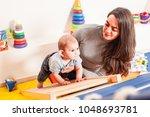interaction between mother and... | Shutterstock . vector #1048693781