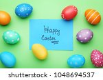 inscription happy easter with... | Shutterstock . vector #1048694537