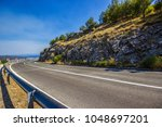 a coast road by the sea in... | Shutterstock . vector #1048697201