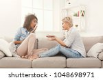 two multiethnic female friends... | Shutterstock . vector #1048698971