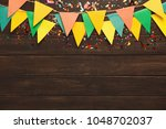 border of colorful paper flags... | Shutterstock . vector #1048702037