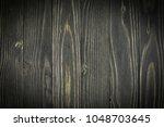 brown wood texture. abstract... | Shutterstock . vector #1048703645