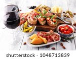 italian antipasti wine snacks... | Shutterstock . vector #1048713839