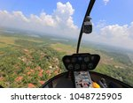 helicopter cabin. helicopter... | Shutterstock . vector #1048725905