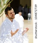 Muslim wearing ihram clothes and ready for Hajj - stock photo