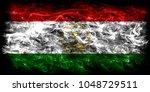 tajikistan smoke flag | Shutterstock . vector #1048729511