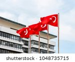 turkish flags with blue sky | Shutterstock . vector #1048735715