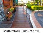 wooden ramp way for support... | Shutterstock . vector #1048754741