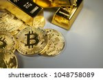bitcoin  and gold background | Shutterstock . vector #1048758089