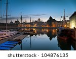 Evening view over the river Motlawa the Old Town in Gdansk, Poland. - stock photo