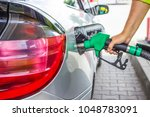 a man pumping gas in to the tank | Shutterstock . vector #1048783091