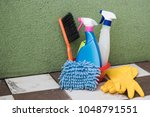 bucket with sponges  chemicals... | Shutterstock . vector #1048791551