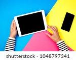 woman's hands with tablet... | Shutterstock . vector #1048797341