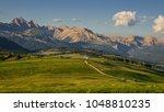 summer eve in alpe di siusi... | Shutterstock . vector #1048810235