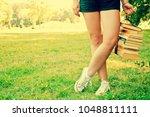 girl hold stack of books.... | Shutterstock . vector #1048811111